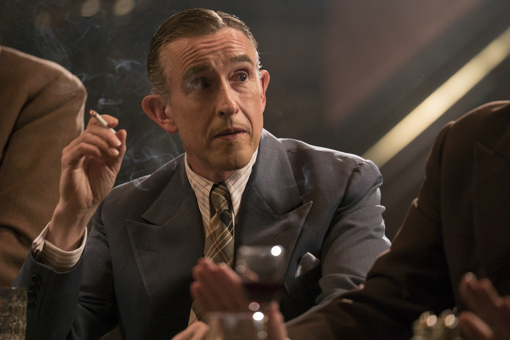 Stan Laurel with a cigarette