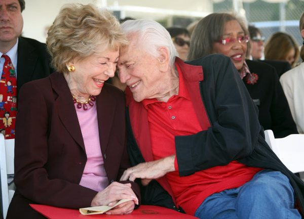 Actor Kirk Douglas and wife Anne Chatting