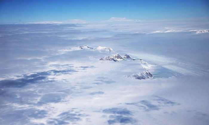 A section of the West Antarctic Ice Sheet with mountains is viewed from a window of a NASA Operation IceBridge airplane on Oct. 31, 2016. (Mario Tama/Getty Images)