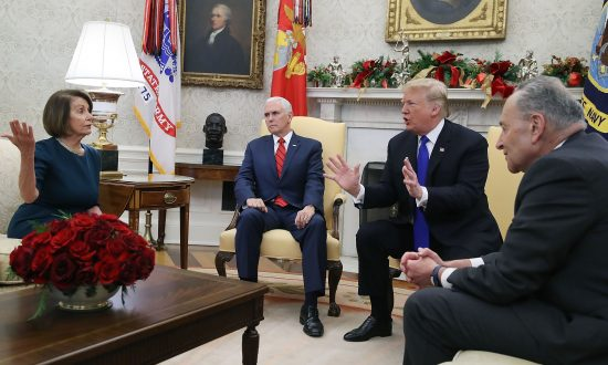 President Donald Trump (2R) argues about border security with Senate Minority Leader Chuck Schumer (R) and House Minority Leader Nancy Pelosi as Vice President Mike Pence sits nearby in the Oval Office on Dec. 11, 2018. (Mark Wilson/Getty Images)