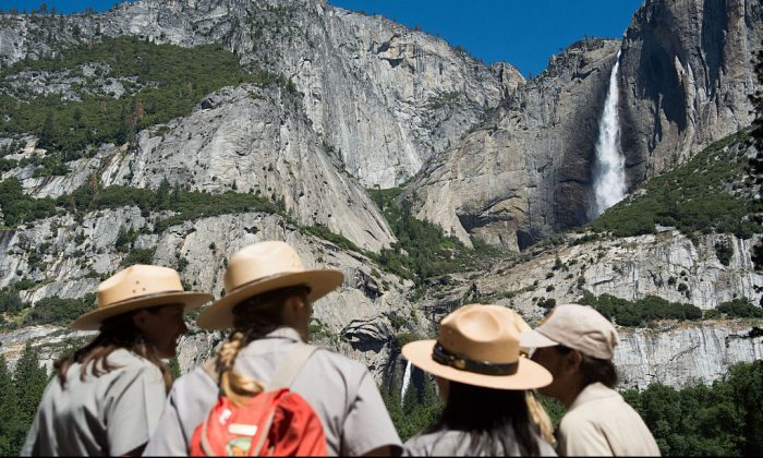 Park rangers meet in front of Yosemite Falls  on June 18, 2016, in Yosemite National Park, California. (David Calvert/Getty Images)