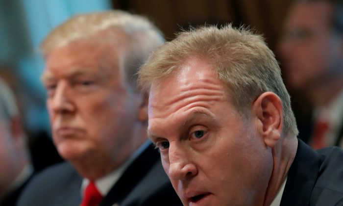 U.S. President Donald Trump (L) listens next to Acting U.S. Defense Secretary Patrick Shanahan during a Cabinet meeting on day 12 of the partial U.S. government shutdown at the White House in Washington, U.S., on Jan. 2, 2019. (Jim Young/Reuters)