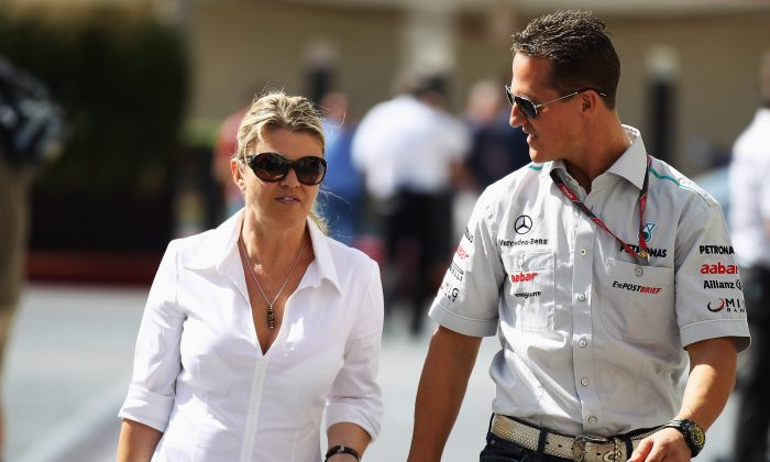 Michael and Corinna Schumacher on Nov. 10, 2011 in Abu Dhabi, United Arab Emirates. (Mark Thompson/Getty Images)