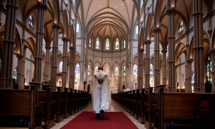 Father Kris Stubna walks to the sanctuary, following a mass to celebrate the Assumption of the Blessed Virgin Mary at St Paul Cathedral, the mother church of the Pittsburgh Diocese, on Aug. 2018 in Pittsburgh, Pa.  (Jeff Swensen/Getty Images)
