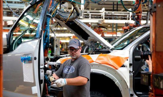 An employee works on the assembly line for the Ford 2018 and 2019 F-150