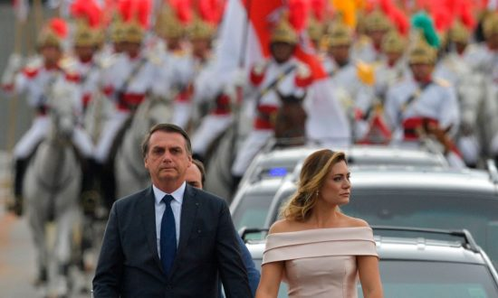 The presidential convoy, led by Brazil's President-elect Jair Bolsonaro (L) and his wife Michelle Bolsonaro in a Rolls Royce, heads to the National Congress for his swearing-in ceremony, in Brasilia on Jan.1, 2019. (Carl De Souza/AFP/Getty Images)