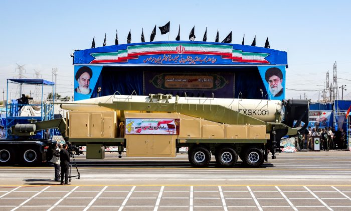 The long-range Iranian missile, Khoramshahr, is displayed during an annual military parade marking the anniversary of the outbreak of the devastating 1980-88 war with Saddam Hussein's Iraq, in the capital Tehran, on Sept. 22, 2018. (STR/AFP/Getty Images)
