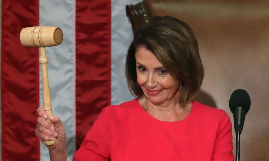 """Speaker of the House Rep. Nancy Pelosi (D-CA) holds the gavel during the first session of the 116th Congress at the U.S. Capitol in Washington on Jan. 3, 2019. The first bill introduced under Pelosi's speakership is titled the """"For the People Act."""" (Mark Wilson/Getty Images)"""