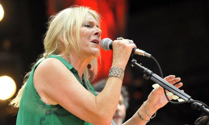 Pegi Young & The Survivors perform with Neil Young during the Farm Aid 2013 concert at Saratoga Performing Arts Center in Saratoga Springs, N.Y. On Sept. 21, 2013. (AP Photo/Hans Pennink)