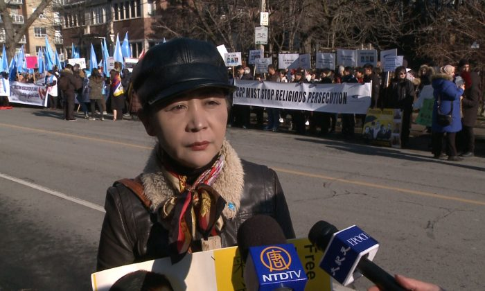 Sheng Xue of the Federation for a Democratic China speaks during a rally outside the Chinese consulate in Toronto on Jan. 4, 2019. Xue was part of the Canadian Coalition Against Communism that organized the rally, attended by around 100 people. (NTD Television)
