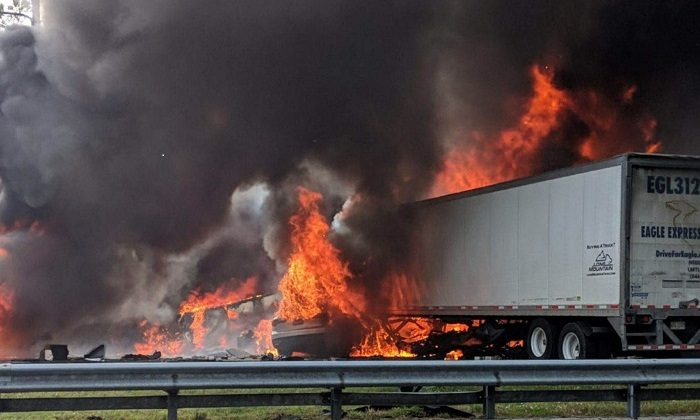 Flames engulf vehicles after a fiery crash along Interstate 75, on Jan. 3, 2019. (WGFL-Gainesville via AP)