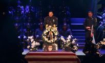 Videos of the Day: Slain Police Officer Called 'American Hero' at His Funeral