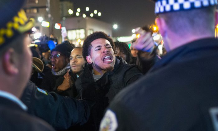 Demonstrators confront police during a protest in Chicago on Nov. 24, 2015. (Scott Olson/Getty Images)