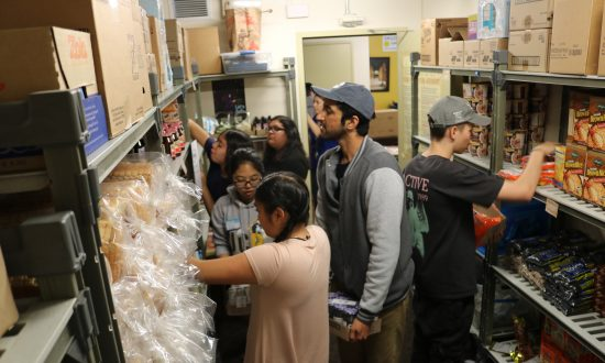 Members of Swipe Out Hunger stock the shelves of the R'Pantry at the University of California-Riverside. (Courtesy of the University of California-Riverside)