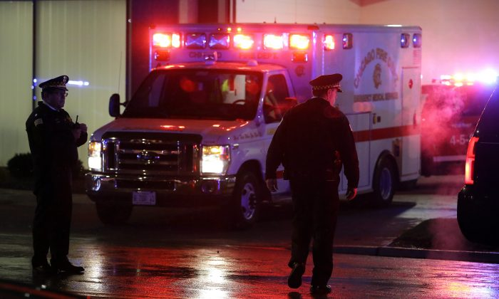 A stock photo shows an ambulance with lights flashing (Joshua Lott/Getty Images)