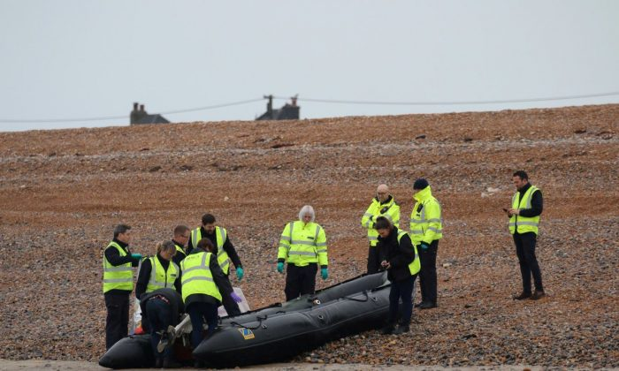 Britain's Border Force carry an intercepted migrant dinghy off the Kent coast, Britain Dec. 31, 2018 in this picture obtained from social media. (Twitter/Susan Pilcher via reuters)
