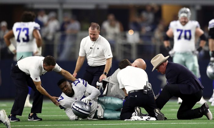 Allen Hurns, No. 17 of the Dallas Cowboys is attended to after being injured during the Wild Card Round against the Seattle Seahawks at AT&T Stadium on Jan. 05, 2019, in Arlington, Texas. (Ronald Martinez/Getty Images)