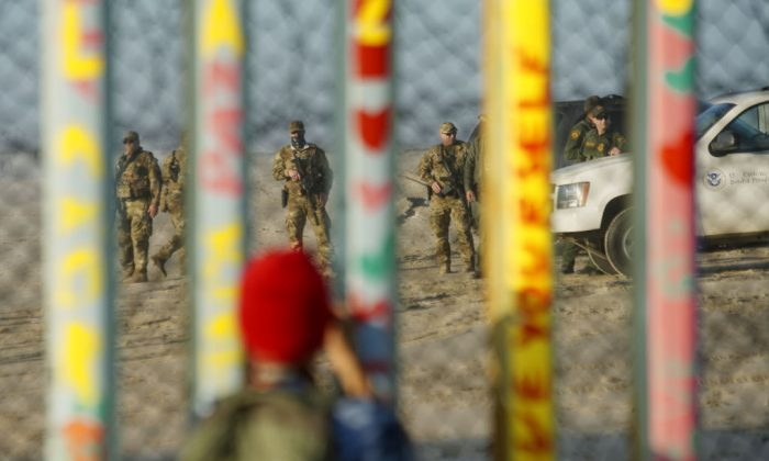 Border Patrol agents stand on patrol along the U.S.-Mexico border wall on Jan. 6, 2019 in Tijuana, Mexico.  (Sandy Huffaker/Getty Images)
