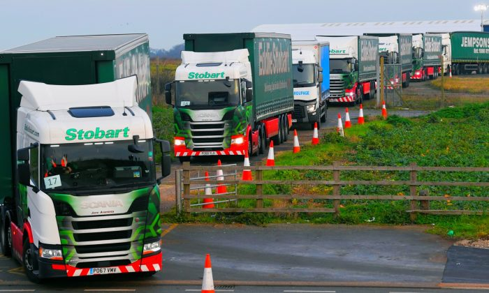 "Lorries leave disused Manston Airport to attend a test drive to the Port of Dover during a trial of how road will cope in case of a ""no-deal"" Brexit, Kent, Britain, on Jan. 7, 2019. Toby Melville/Reuters)"