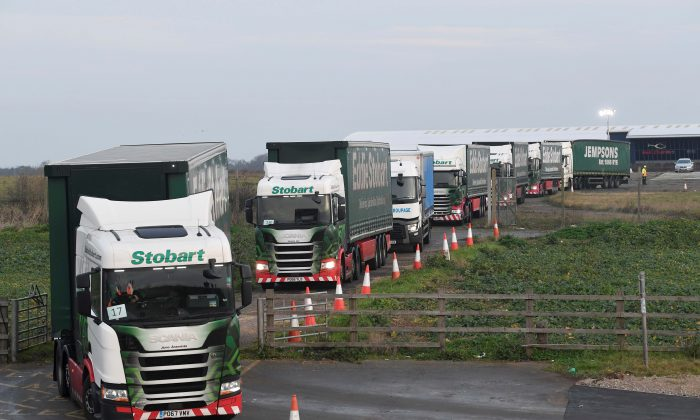 "Trucks leave disused Manston Airport to attend a test drive to the Port of Dover during a trial of how roads will cope in the event of a ""no-deal"" Brexit, in Kent, United Kingdom, on Jan. 7, 2019. (Reuters/Toby Melville)"