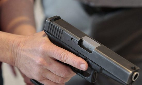 A person holds a gun in a file photo. (George Frey/Getty Images)