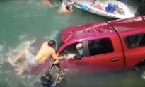 Elderly Mother, Son, and Dog Saved in Dramatic Rescue After Truck Plunges into Water