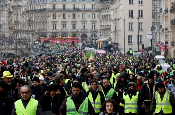 Protesters wearing yellow vests take part in a demonstration by the 'yellow vests' movement in Paris on Jan. 5 2019