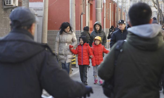 Children are escorted from the site of an attack at the  Beijing No. 1 Affiliated Elementary School of Xuanwu Normal School in Beijing on Jan. 8, 2019. A male attacker injured 20 children inside the primary school in China's capital, officials said. (Ng Han Guan/AP)