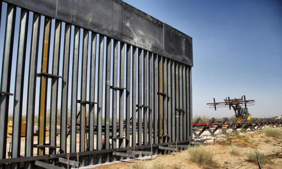 Workers are photographed during construction of approximately 20 miles of the border wall by order of President Donald Trump on the border between Ciudad Juarez, Chihuahua state, Mexico and Santa Teresa, New Mexico state, on April 17, 2018. (Herica Martinez/AFP/Getty Images)