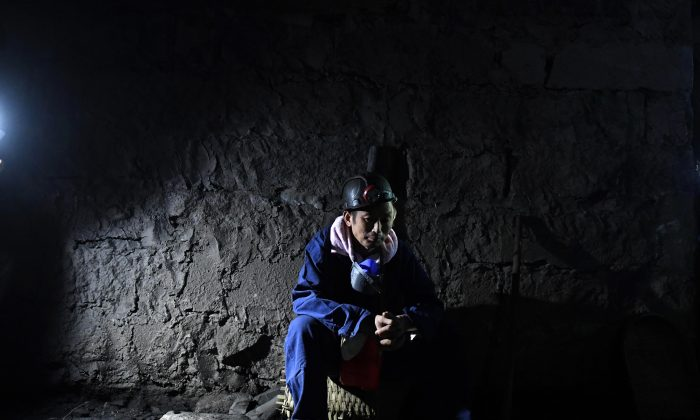 A rescuer inside the Jinshangou Coal Mine in Yongchuan District of Chongqing City, China, on Oct. 31, 2016. The missing case files at China's supreme court involved a mining rights legal dispute. (STRINGER/AFP/Getty Images)