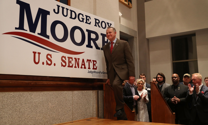 Republican Senatorial candidate Roy Moore arrives on stage to speak about the race against his Democratic opponent Doug Jones  in Montgomery, Alabama, on Dec. 12, 2017. (Joe Raedle/Getty Images)