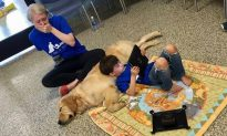 Crying Mom Silently Watches Her Son With Autism Cuddling a Service Dog
