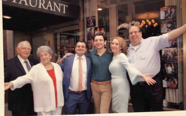 Scognamillo family outside of Patsy's Italian Restaurant