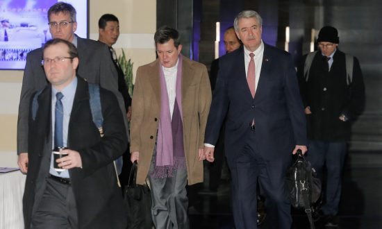 Ted McKinney (2nd R), the U.S. undersecretary for trade and foreign agricultural affairs and a member of the U.S. trade delegation to China, leaves a hotel with other officials in Beijing, on Jan. 7, 2019. (Thomas Peter/Reuters)