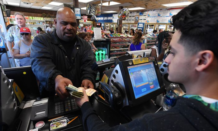 A man purchases lottery tickets in a liquor store in Torrance, Calif., on Oct. 19, 2018. (MARK RALSTON/AFP/Getty Images)