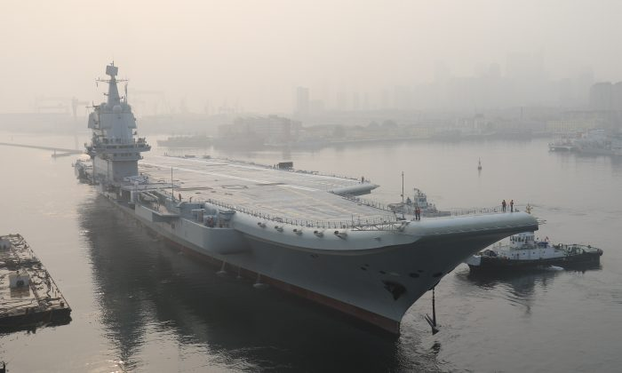 """China's first domestically manufactured aircraft carrier, known only as """"Type 001A,"""" leaves port in the northeast city of Dalian early on May 13, 2018. (AFP/Getty Images)"""