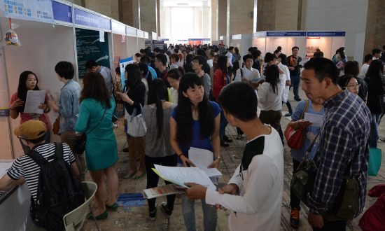 Chinese jobseekers attend a jobs fair in Beijing on May 18, 2013. (Mark Ralston/AFP/Getty Images)