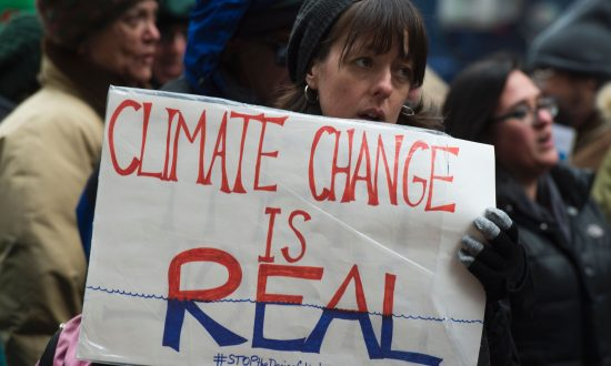 Climate activists rally to urge politicians to stand against climate change denial on Jan. 9, 2017, in New York. Equating skepticism of the severity or urgency of climate change with denial that climate change exists is wrong, argues Richard Trzupek. (DON EMMERT/AFP/Getty Images)