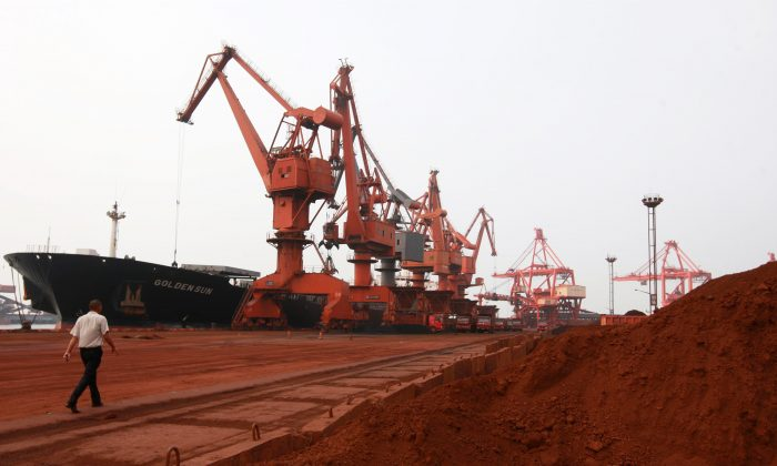 Soil containing various rare earth minerals is loaded onto a ship at a port in Lianyungang, east China's Jiangsu province on Sept. 5, 2010, for export.  (STR/AFP/Getty Images)