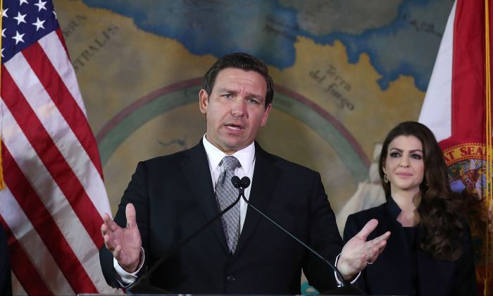 Newly sworn-in Gov. Ron DeSantis speaks as his wife, Casey DeSantis, stands near him at the Freedom Tower where he appointed Barbara Lagoa to the Florida Supreme Court in Miami, Fla., on Jan. 09, 2019. (Joe Raedle/Getty Images)