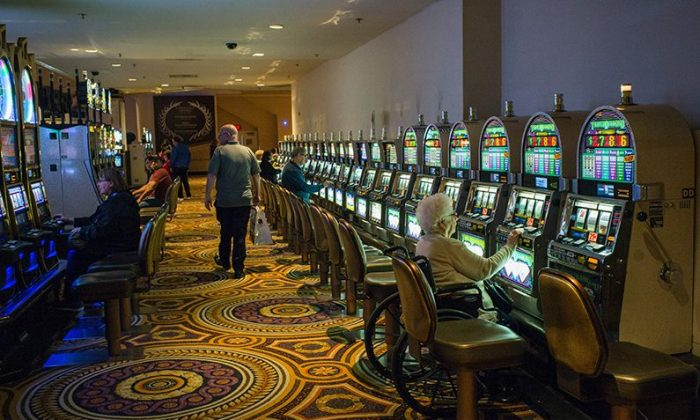 A woman plays the slot machine in a casino in Atlantic City, New Jersey, on May 8, 2016. (Jewel Samad/AFP/Getty Images)