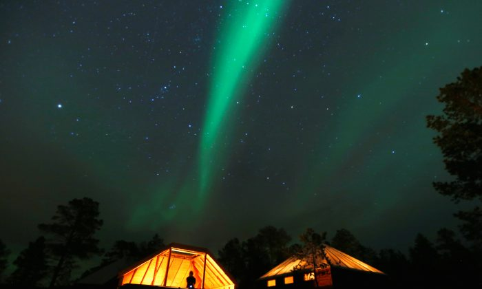 The Aurora Borealis (Northern Lights) is seen over a mountain camp north of the Arctic Circle, near the village of Mestervik on Oct. 1, 2014. (Reuters/Yannis Behrakis)