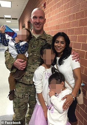 Gooch with wife and three kids
