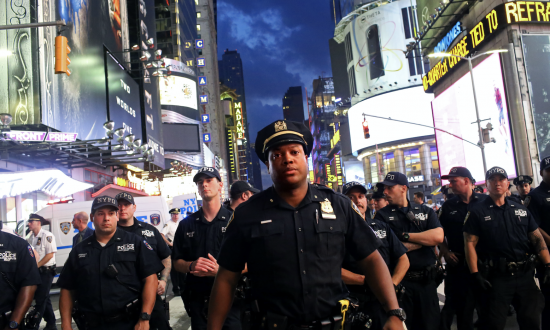 Police watch activists protest in Times Square in response to the recent fatal shootings of two black men by police in New York City, on July 7, 2016. (Yana Paskova/Getty Images)
