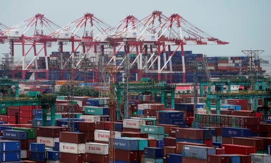Shipping containers are seen at a port in Shanghai, China on July 10, 2018. (Aly Song/Reuters)