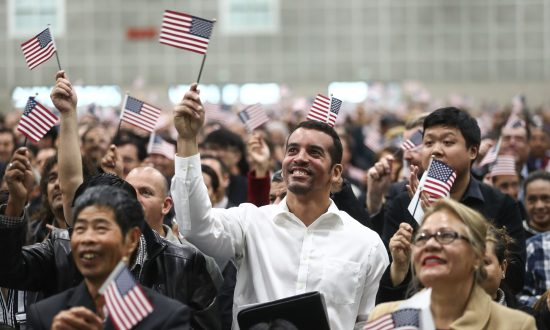 New U.S. citizens wave American flags at a naturalization ceremony on March 20, 2018, in Los Angeles, California. The naturalization ceremony welcomed more than 7,200 immigrants from over 100 countries who took the citizenship oath and pledged allegiance to the American flag. (Mario Tama/Getty Images)