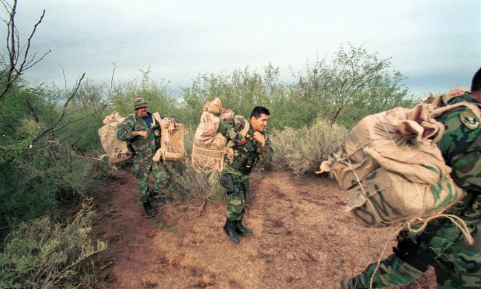 Native American Customs and Border Protection officers remove hundreds of pounds of marijuana in backpacks from the desert, near the Mexican border on the Tohono O'Odham Indian Reservation in Arizona, in this file photo. (U.S. Customs/Getty Images)