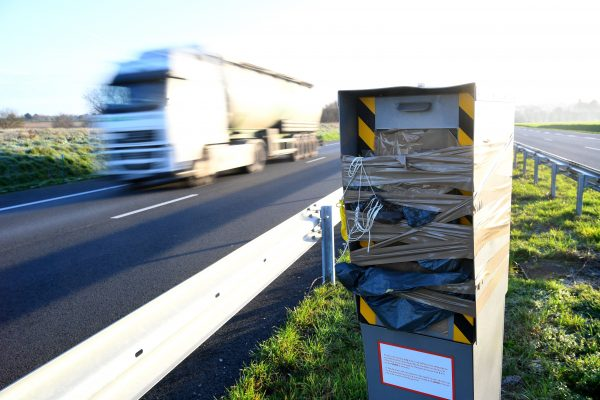 A speed camera covered by tape and a plastic bag after being damaged to block its operation
