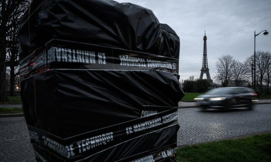"A speed camera in Paris covered by a plastic sheet and tape reading ""under technical maintenance,"" after it was damaged to block its operation. Pictured on Jan. 10, 2019. (Philippe Lopez/AFP/Getty Images)"