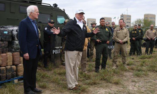 President Donald Trump speaks with Border Patrol agents next to Sen. John Cornyn near the Rio Grande, Texas, on Jan. 10, 2019. (Jim Watson/AFP/Getty Images)